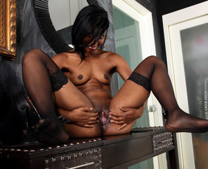 Young ebony beauty in stockings..