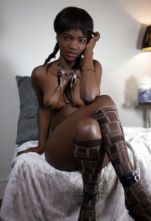 Perfect bodied black cutie posing nude..