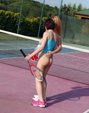 Two tennis girls making lesbian love..